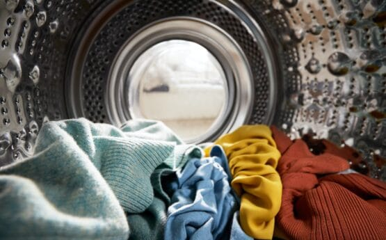 View Looking Out From Inside Washing Machine Filled With Laundry