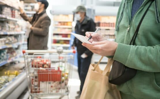 Woman with a shopping list at a grocery store